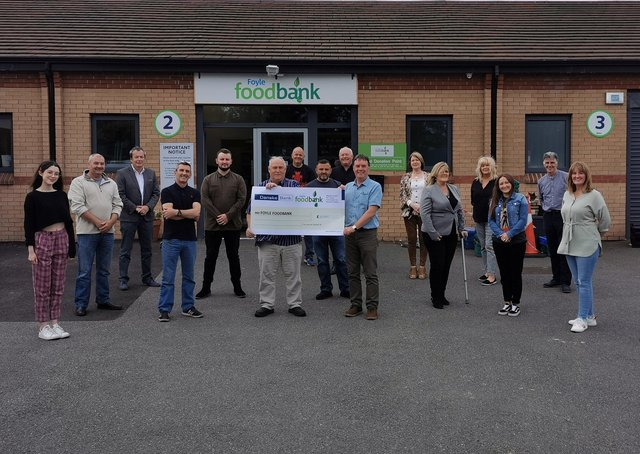 ABOVE: Artists and performers from the Magnificent Seven crew handing over the cheque for £10,000 to staff from the Foyle Foodbank.