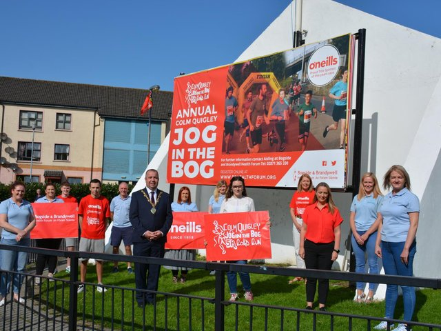 Gearing up for the virtual 'Colm Quigley Jog in the Bog 2020' during the week commencing October 5th 2020 are Mayor of Derry City and Strabane District Council, Councillor Brian Tierney; Enya Quigley, daughter of Colm Quigley; Aileen McGuinness, General Manager of the Bogside and Brandywell Health Forum; Caroline Casey from O'Neill's, and staff and volunteers from the Bogside and Brandywell Health Forum.
