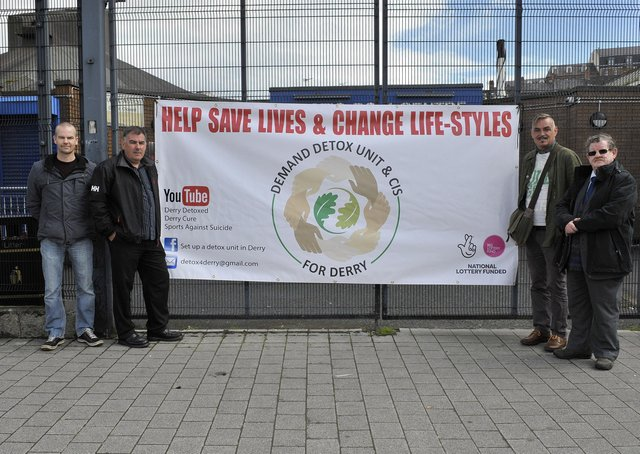 2017: Derry Detox campaign members  Gavin Patton, George Cairns, (the late) Tomas O' Tiomanaigh and Fionnbarra O'Dochartaigh pictured at Pilots Row Centre, at the unveiling of a banner.  DER3017GS094