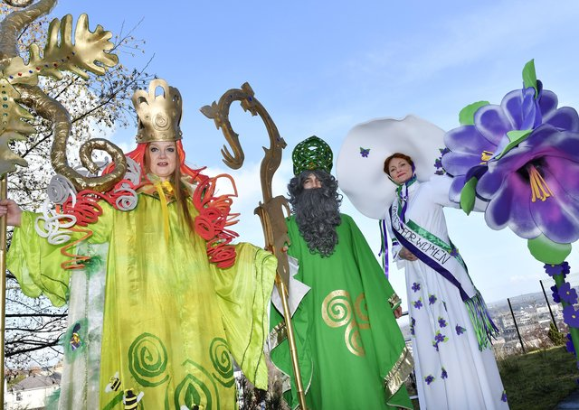2018: Stilt walkers Audrey Doherty (Brigid), Michael Johnston (St. Patrick) and Sorcha Shanaghan (Suffragette) who featured in the annual St. Patrick's Day parade. DER1118-129KM
