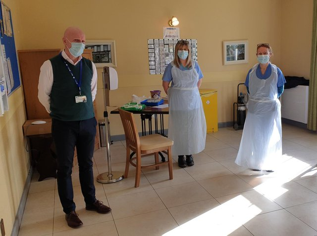 Dr. Bob Brown with staff at Slieve Na Mon Care Home in Omagh