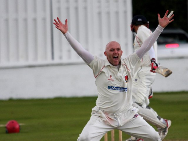 Strabane's Peter Gillespie celebrates claiming another wicket. Picture courtesy Barry Chambers