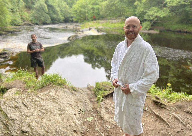 Barra Best prepares  to take the plunge in the River Roe with ice water instructor Aaron Deane.