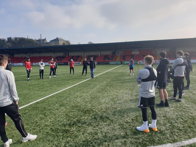 Clinical psychologist and family therapist, Gerry Cunningham introduces himself to Derry City players at training on Tuesday.