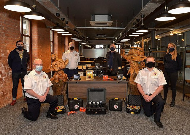 A donation totalling £39,000 from local video game developer Hypixel Studios, parent company Riot Games Social Impact fund, the owners of the Hypixel Minecraft server, Hypixel Studios CEO Aaron Donaghey, and an anonymous donor has enabled Foyle Search & Rescue to upgrade  its drone program. Pictured at the Hypixel Studios in Patrick Street yesterday afternoon are, from left, Shay Glenn, Officer Manager Hypixels Studios, Sean Durnin, FSR Drone Team, Pat Carlin, FSR Chairman,  Sean McCafferty, Chief Operating Officer of Hypixel Studios, Paul Smith, FSR Drone Team Co-ordinator and Holly Johnston, Recruitment Officer Hypixel Studios.  DER2109GS – 009