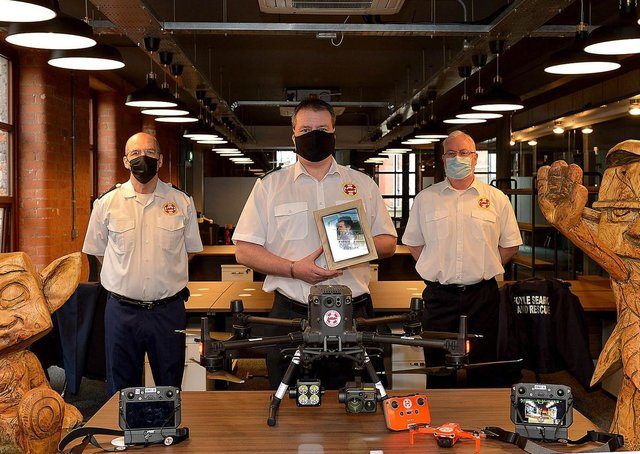 Foyle Search & Rescue members Pat Carlin, Chairman, Paul Smith, Drone Team Co-ordinator and Sean Durnin, Drone Team, pictured at Hypixel Studios Derry with upgraded drone equipment facilitated by a donation totalling £39,000 from local video game developer Hypixel Studios, parent company Riot Games Social Impact fund, the owners of the Hypixel Minecraft server, Hypixel Studios CEO Aaron Donaghey, and an anonymous donor. The drone is named Delta November (DN1) after FSR team member localman Danny Nelis who died on 12 January 2019. DER2109GS - 010