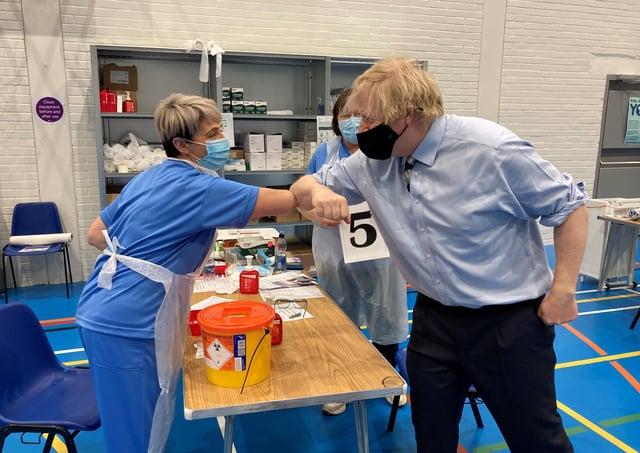 Prime Minister Boris Johnston greets Western Trust Vaccination Team Staff.