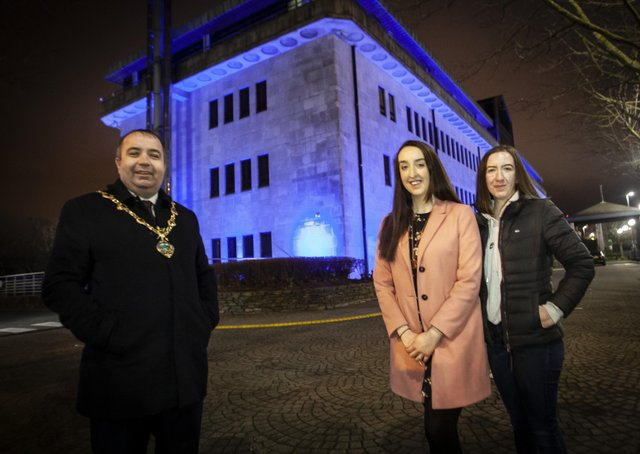 OVARIAN CANCER AWARENESS.. . . . . .The Mayor of Derry City and Strabane District Council, Brian Tierney pictured with Ovarian Cancer campaigner Natalie Cairns and her sister Angela at the Council Offices, Strand Road on Monday night which was lit up to raise awareness of Ovarian Cancer.