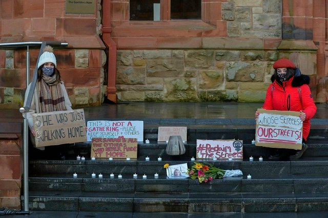 Hannah McIvor and Ciara Oâ€TMConnor-Pozo placed candles, flowers and placards on the Guildhall steps on Saturday evening last in remembrance of  Sarah Everard. Photos: George Sweeney / Derry Journal.  DER2110GS – 108