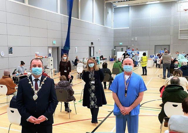 The Mayor Brian Tierney with health staff at Foyle Arena.