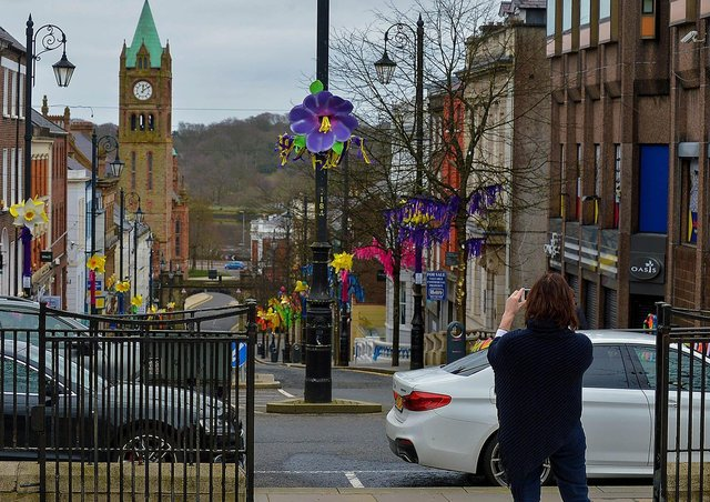 Taking a snap of a colourful Shipquay Street to celebrating St Patrick's Day. DER2110GS – 009