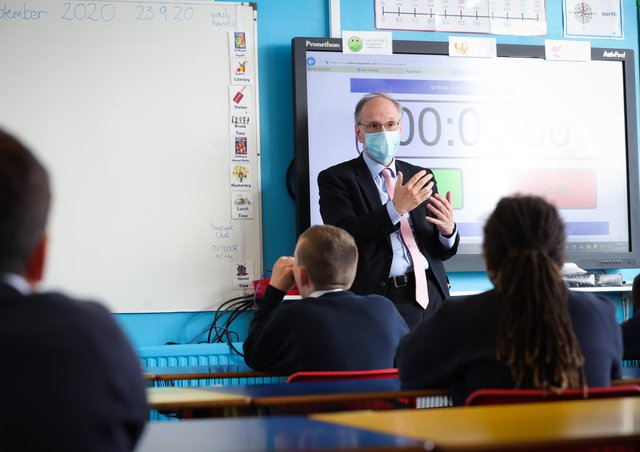 Education Minister Peter Weir speaking with school pupils last year. Photo by Kelvin Boyes / Press Eye.