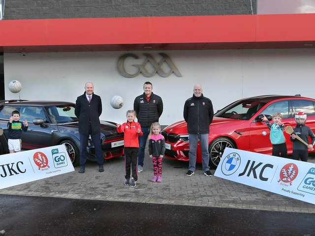 From left, Niall MacFlynn (JKC BMW), Derry County Chairperson, Stephen Barker, and County Secretary, Sean Keane with young players at the official announcement of JKC as the official partner of the 2021 Derry Go Games programme.