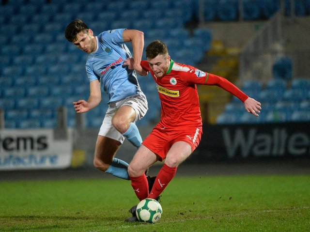 Longford Town defender Joe Gorman pictured playing for Cliftonville against Ballymena's Adam Leckey.