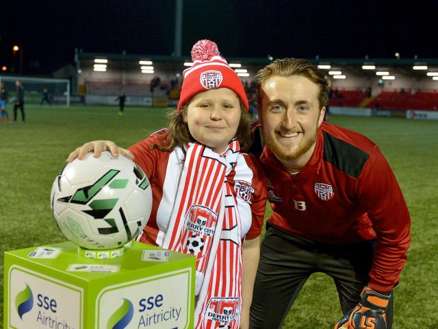 Nathan Gartside pictured with a young Derry City fan at Brandywell.