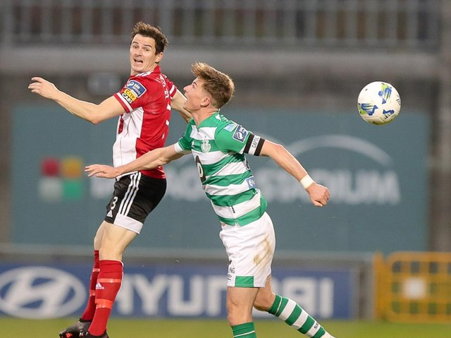 Ciaran Coll pictured in action against Shamrock Rovers' Ronan Finn.