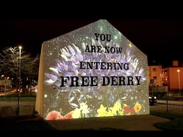 A projection by Visual Spectrum Studio at Free Derry Wall that features in Equinox.