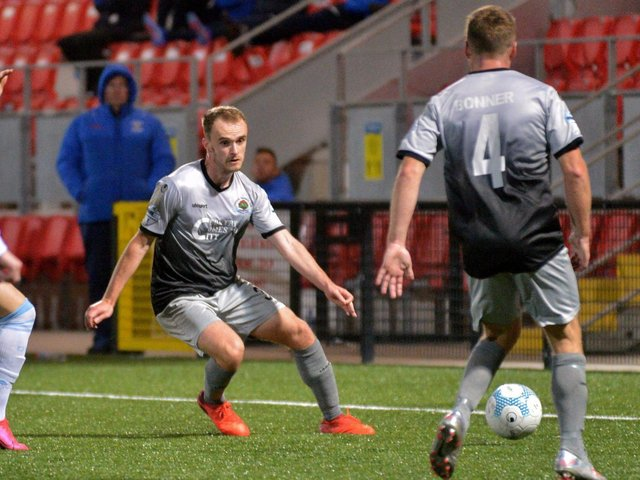 Defender Conor Quigley in action against Strabane Athletic, in one of the few games he played for Institute last year.