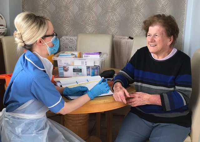 Fionnuala Bell with patient Mary Porter (85) in Derry.