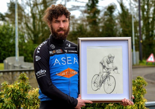 Danny Quigley, who will complete 10 ironman triathlons in 10 days, in memory of his late father, raising funds for suicide awareness pictured with a sketch of his dad. Photo: George Sweeney. DER2112GS - 001