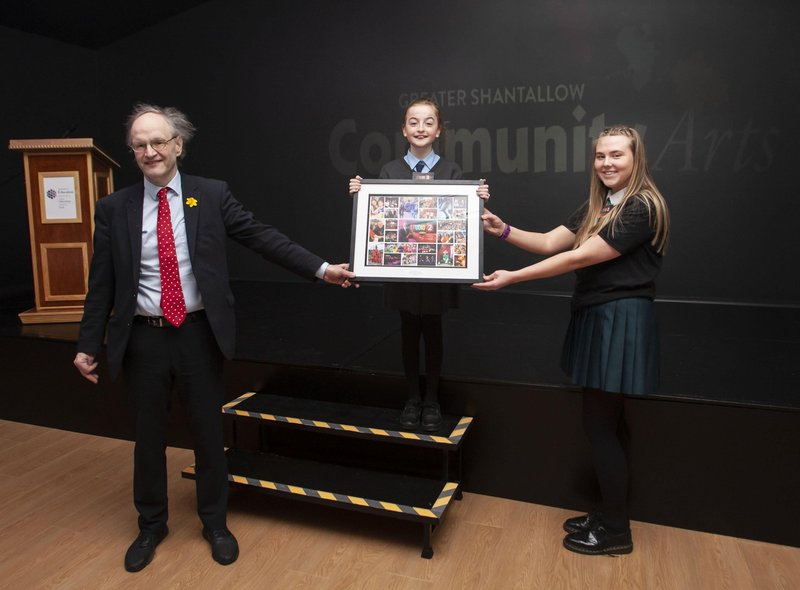 Education Minister Peter Weir is presented with a special memento by Molly McGee and Holly Bonner during Wednesdayâ€TMs  official opening of the newly refurbished Studio 2 Youth and Community Arts Centre. (Photos: Jim McCafferty Photography)