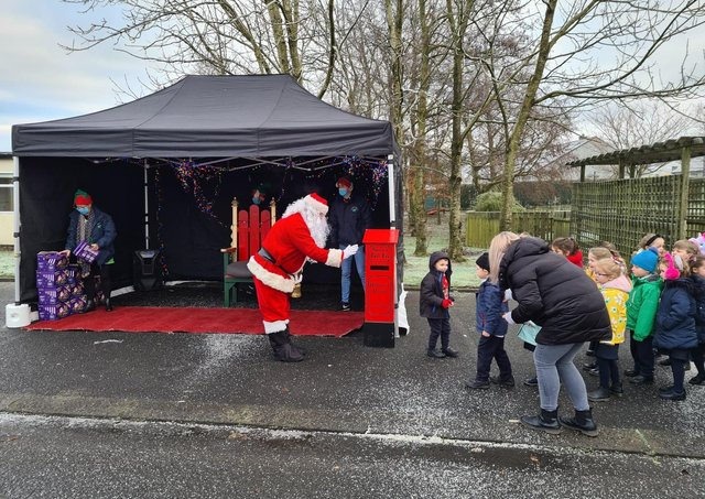 Local children meeting Santa outdoors in the run up to Christmas.