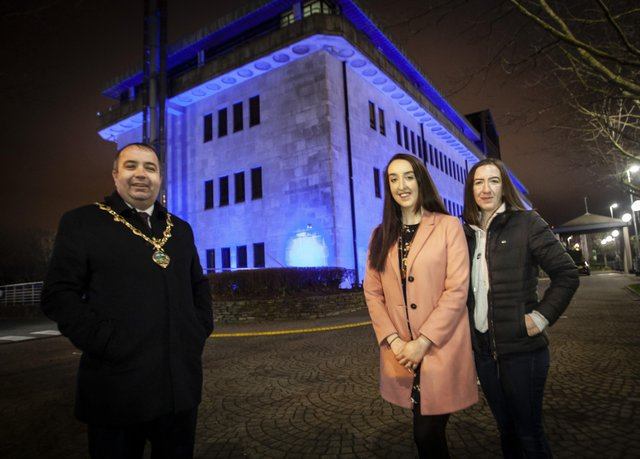 OVARIAN CANCER AWARENESS.. . . . . .The Mayor of Derry City and Strabane District Council, Brian Tierney pictured with Ovarian Cancer campaigner Natalie Cairns and her sister Angela at the Council Offices, Strand Road recently as they were lit up to raise awareness of Ovarian Cancer.