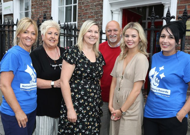 HURT representatives are among those being invited to speak about their work. (Pictured back in 2018 is Derry Girl Saoirse Monica Jackson (Erin) on a visit to National Lottery funded HURT (Have Your Tomorrows) family support group and suicide prevention charity, with staff members Pauline McCloskey, Sadie Reilly, Olivia Smith, Dessie Kyle and Tina Burns.)