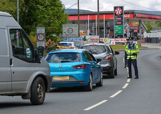 Members of An Garda Síochána operate a vehicle checkpoint on the main Muff to Derry border crossing previously.  DER1920GS – 004