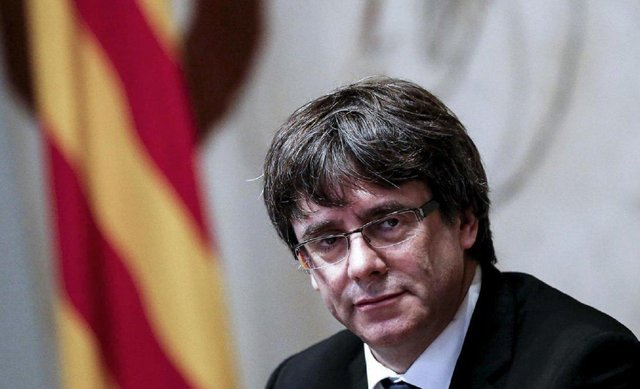 Former President of Catalonia Carles Puigdemon is in exile.