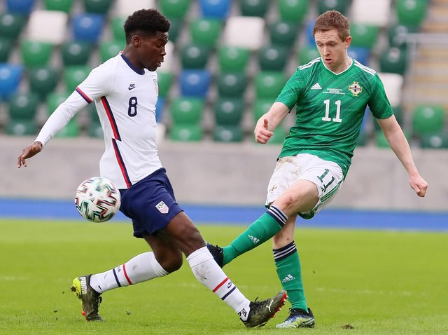 Northern Ireland's Shane Ferguson gets his pass away before USA winger Yunus Musah could challenge. Picture courtesy Jonathan Porter/PressEye