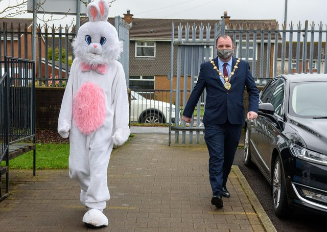 Derry City and Strabane District Council Mayor, Councillor Brian Tierney with the Easter bunny pictured during visits to local schoolchildren this week. Picture Martin McKeown. 29.03.21