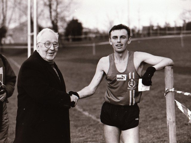 Bobby Farren is congratulated after winning his fourth successive Ulster Cross Country Championship in 1996