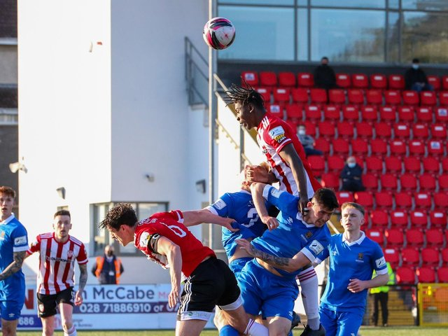 Danny Lupano rises highest to meet this ball during Derry City's Premier Division clash with Waterford. Photo by Kevin Moore.