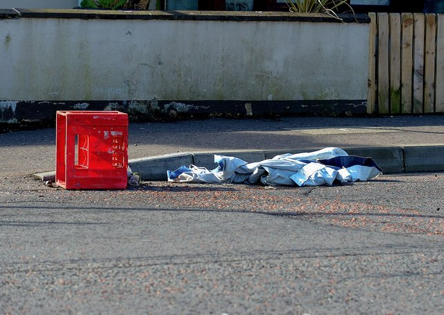 Items of clothing and a crate discarded at the Dungiven Road entrance to Irish Street where violence erupted on  Friday and Sunday evening last. DER2114GS – 003