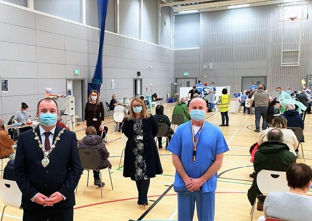 The Mayor Brian Tierney with Western Trust staff at the Foyle Arena vaccination hub.