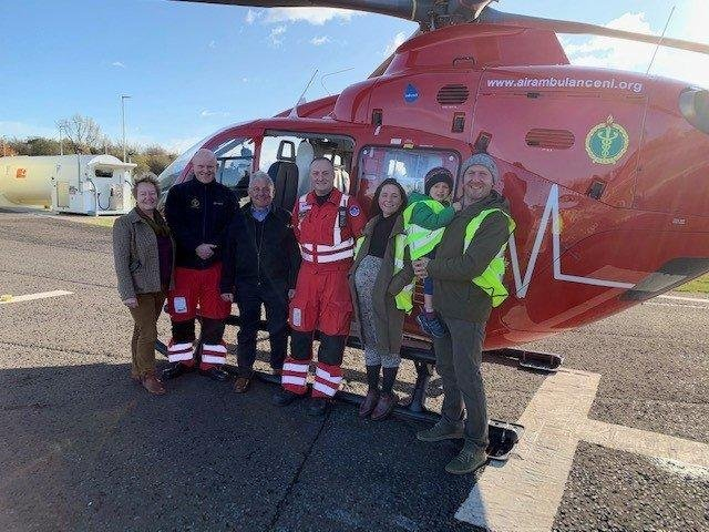 David Thompson, who was injured in a farm accident last year, pictured with and his family, HEMS paramedic Jason Rosborough and HEMS Doctor Russell McLaughlin.