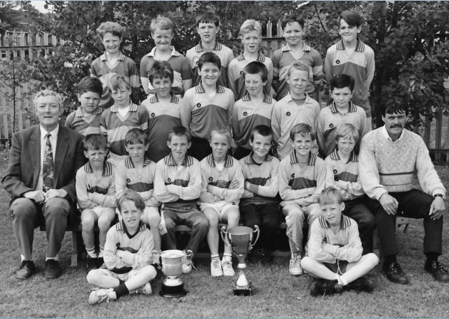 Mr Sean Friel, pictured left, with a colleague and past pupils, is fondly remembered by all who knew him.