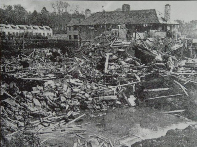 Bomb damage caused by a Luftwaffe parachute mine at Messines Park on April 15, 1941.