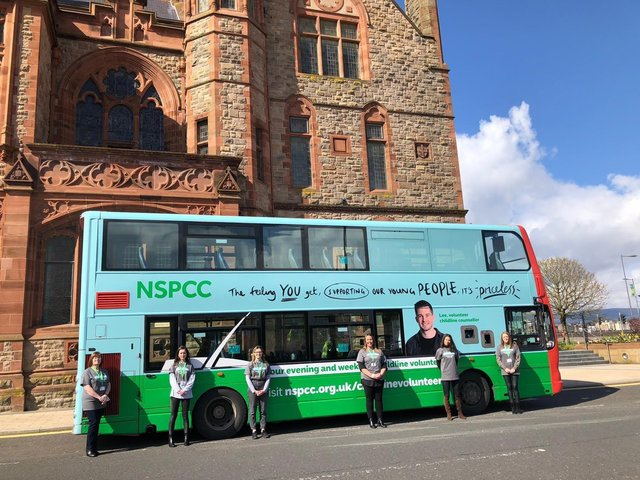 Childline volunteers pictured with a double decker bus servincing routes in the city which is calling for more volunteers.