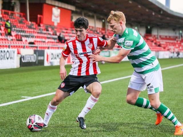 Brendan Barr holds off Liam Scales of Shamrock Rovers during the Airtricity League clash at the Ryan McBride Brandywell Stadium. Picture by Kevin Moore.