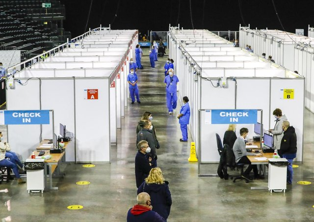 People queue for the first and sometimes second dose of Covid-19 vaccine in the SSE Arena in Belfast.