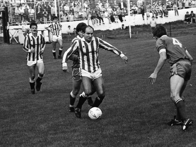 Former Sunderland and Manchester City winger Dennis Tueart in action in Derry City's first game in the League of Ireland against Home Farm, at a packed Brandywell way back in 1985.