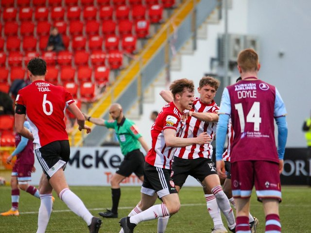 Cameron McJannet races to lift the ball out of the back of the Drogheda net after Ronan Boyce's bullet header at Brandywell on Friday night. Picture by Kevin Moore.