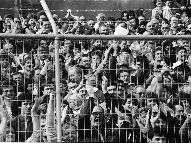 Derry City fans pack into the Brandywell Stadium to watch their hometown team play its first game in the League of Ireland against Home Farm in September 1985.