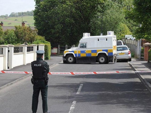 PSNI officers pictured at the scene in Eglinton after the home of a PSNI officer was targeted when a bomb was left under a car on June 18. 2015 DER2415MC056