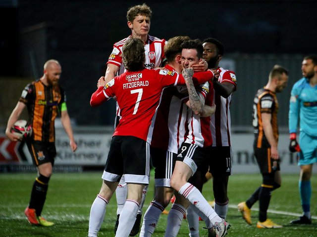 FIGHTING SPIRIT: Derry City players celebrate Cameron McJannet's second half equaliser against Dundalk. (PIcture by Kevin Moore).