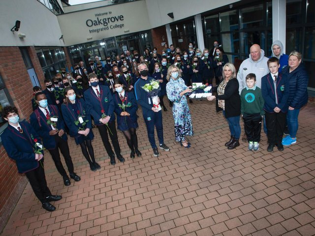 Mrs Katrina Crilly (Principal) presenting Lee's mum Jacqueline Gurney with Lee's Oakgrove Leavers Hoodie at Oakgrove Integrated College on Monday. Included are sixth form students and members of staff. On right also are Lee's dad Derek, brothers Jay and Cain, and family friend Melanie Toland. (Photos: Jim McCafferty Photography)