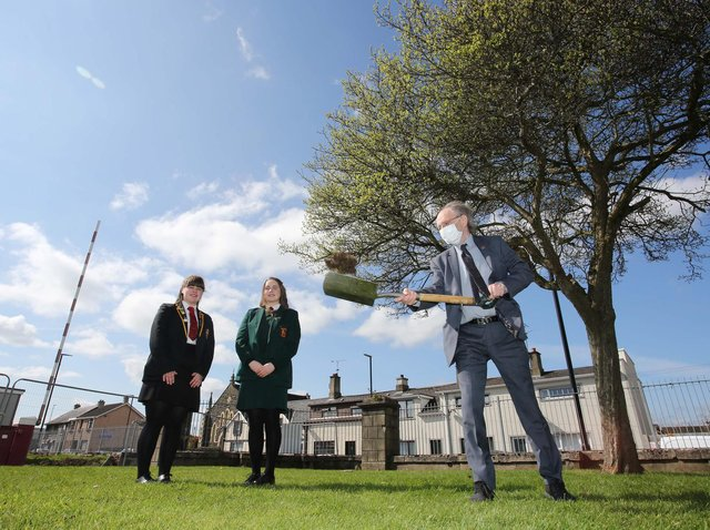 Education Minister Peter Weir visiting Limavady Shared Education Campus to cut the first sod on the new £11 million scheme. Looking on are students  Leah Craig and Clara Clements.