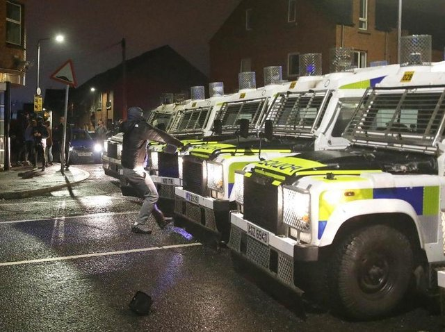A confrontation at police lines in West Belfast.